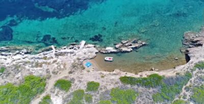 An enchanting beach and island to swim off in Attica