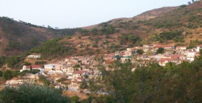 The Greek village where the houses are built one stitched to the other