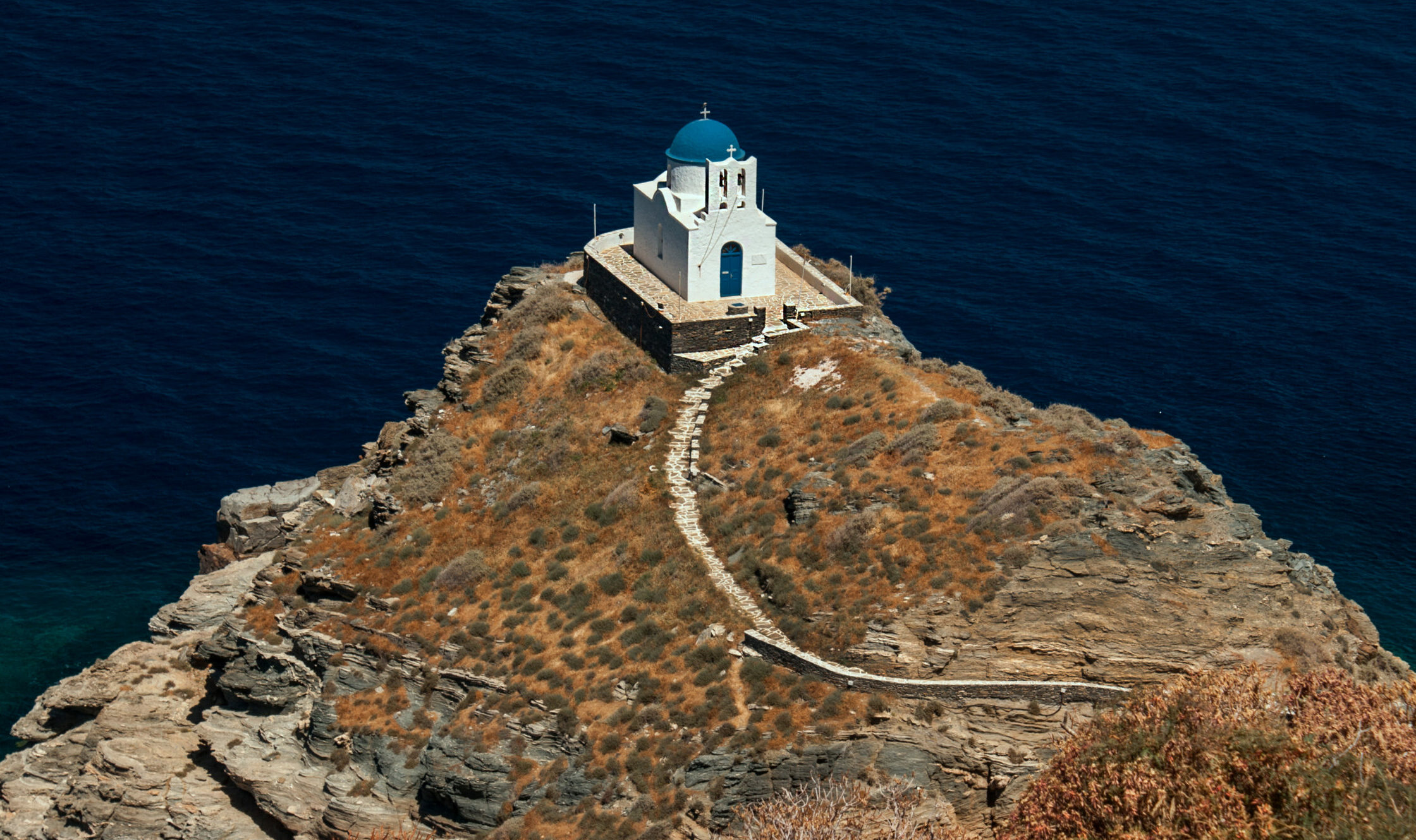 Which is the small Greek island with the 235 churches?