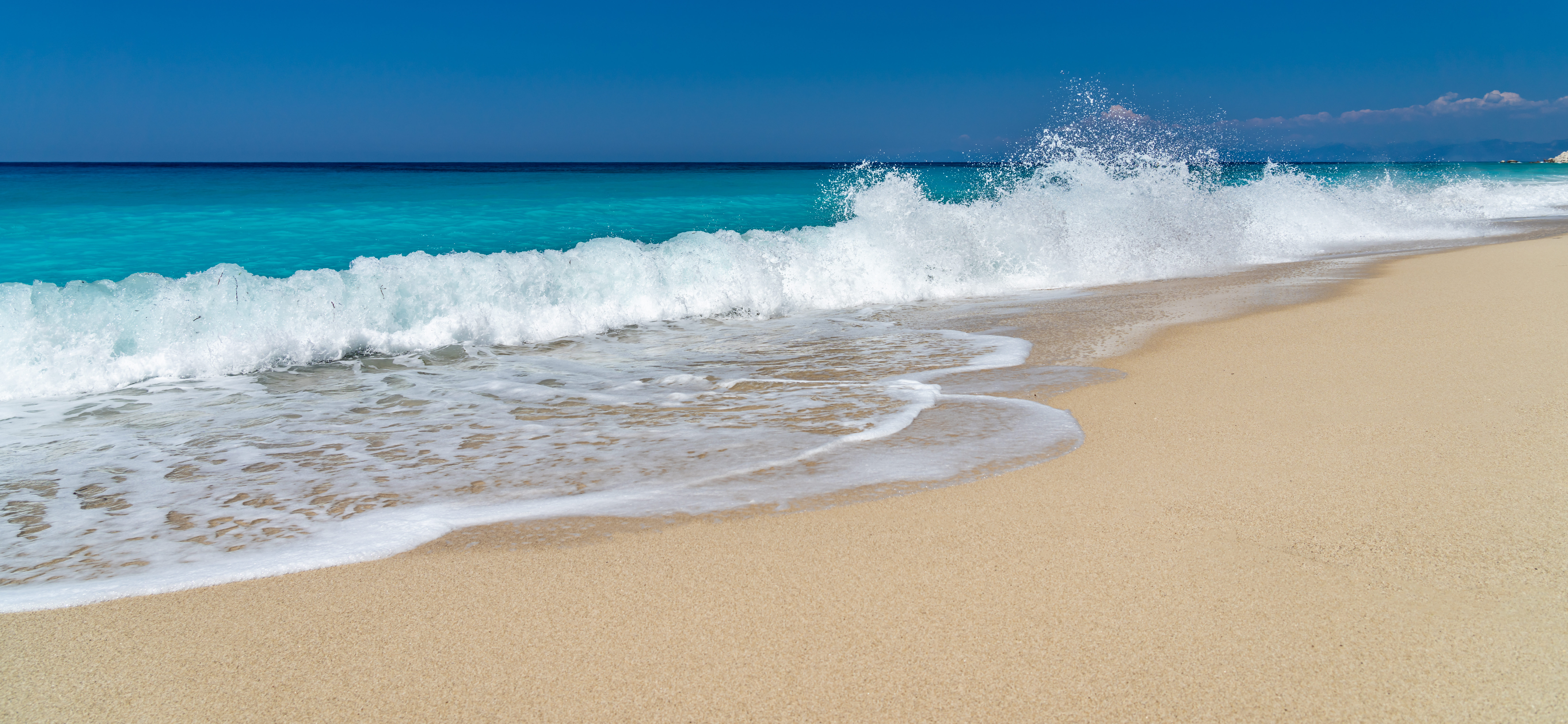 Pefkoulia: The blue beach that you enjoy even the wave