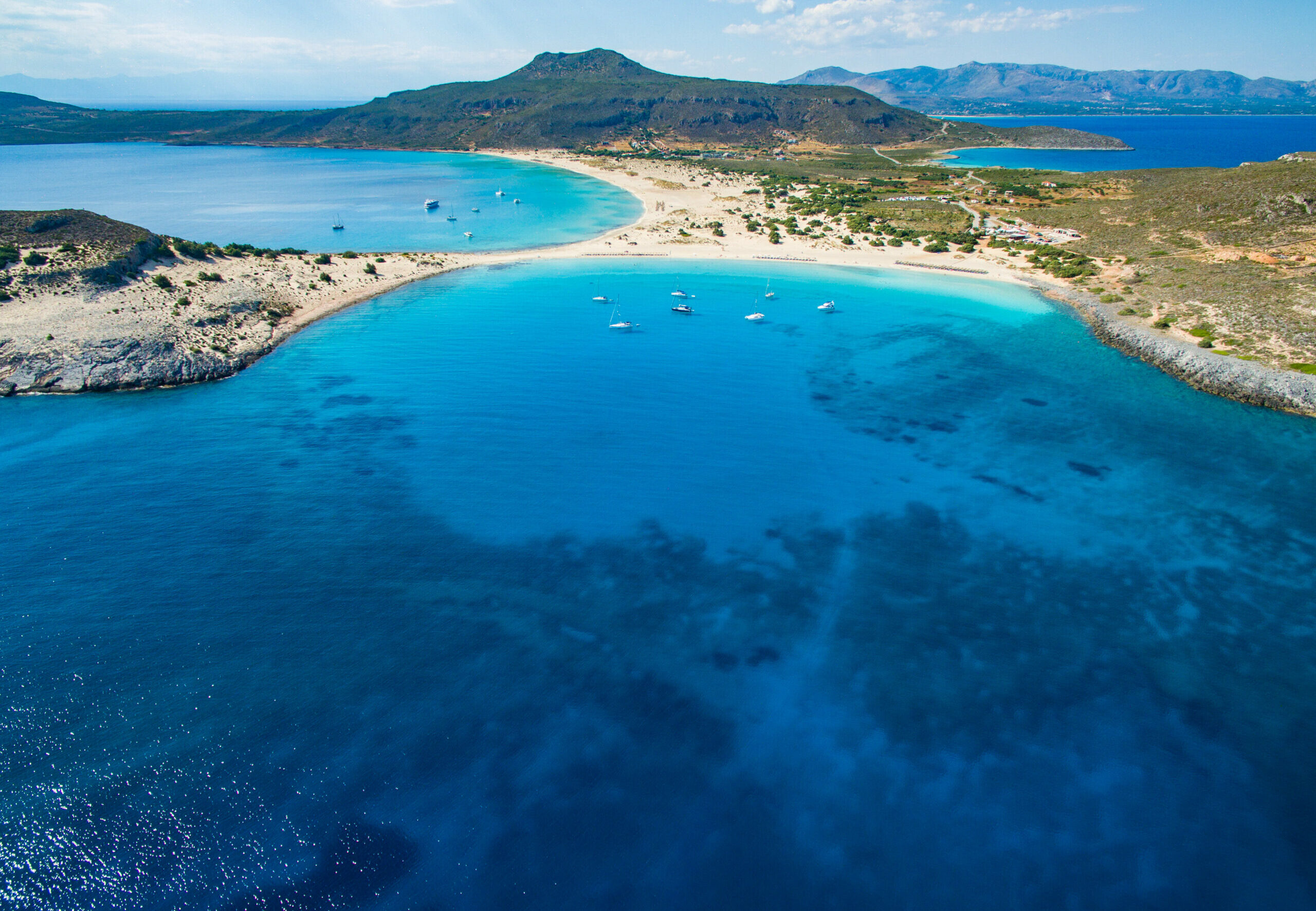 Simos: 1.5 km turquoise beach and white sand