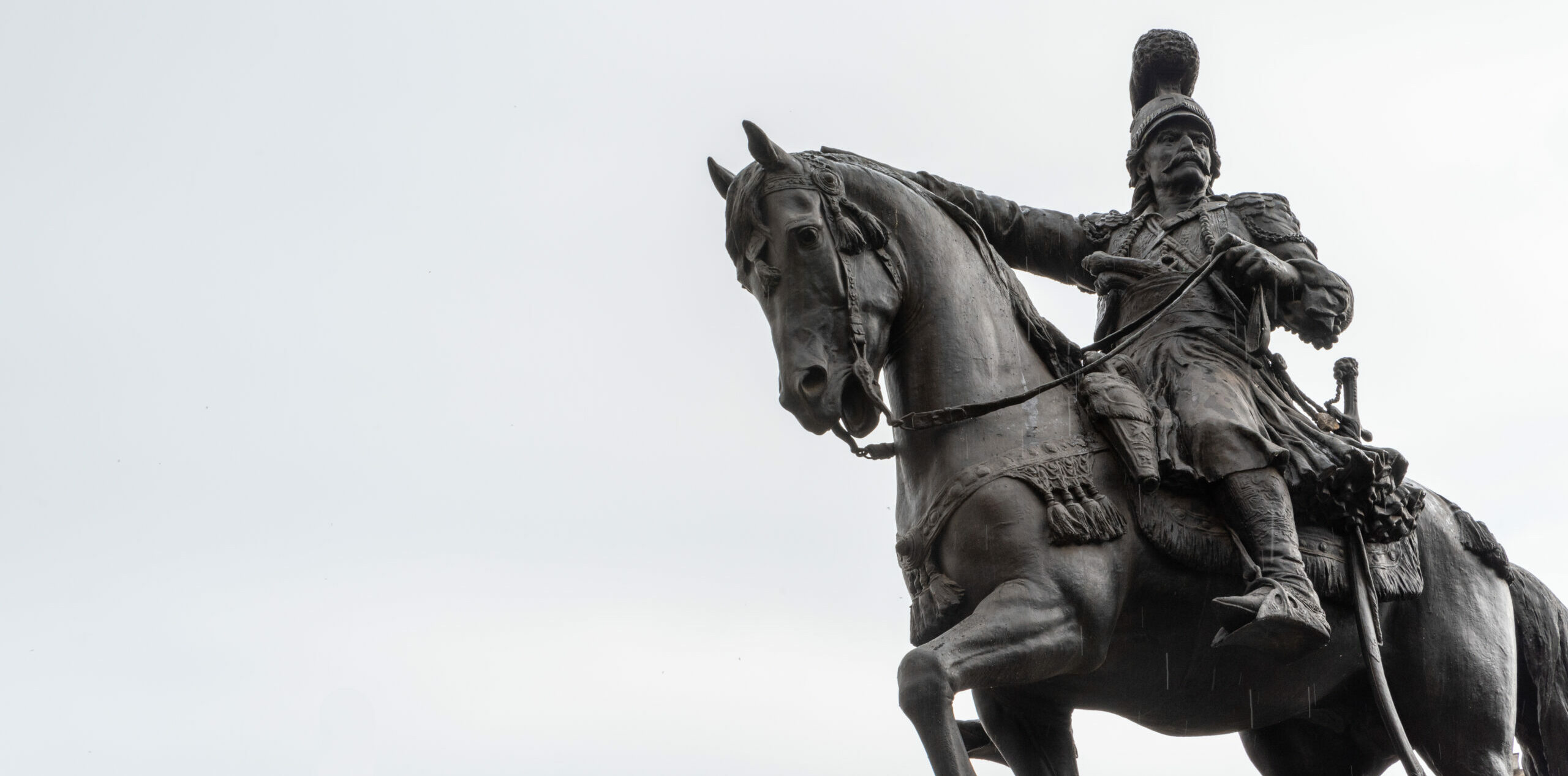 What is Theodoros Kolokotronis pointing at, and what's curious about the stance of his horse?