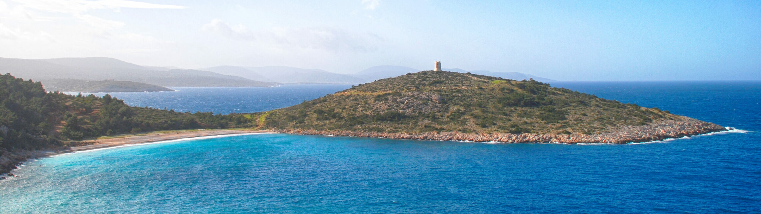 The cylindrical towers on the coastline of Chios and what they symbolize